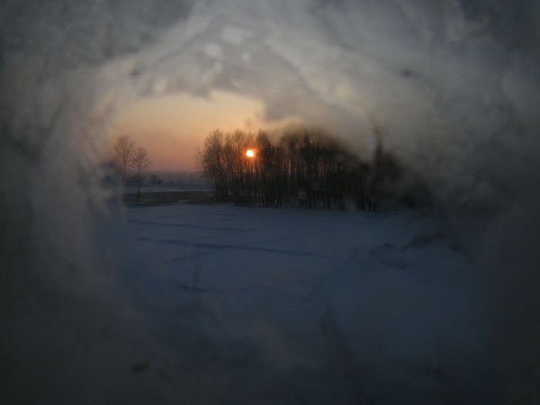 091227車窓から夕日